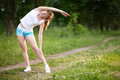 Young woman doing morning exercises on nature Royalty Free Stock Image