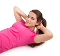 Young woman doing sit ups sporty girl on a white background Stock Photos