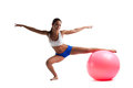 Young woman doing split with fitness ball isolated Stock Image