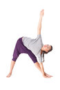 Young woman doing yoga exercise extended triangle pose Stock Photo