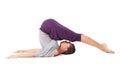 Young woman doing yoga exercise Halasana (Plow Pose). Isolated o