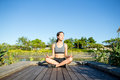 Young woman doing yoga exercise outdoor Royalty Free Stock Photo