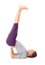 Young woman doing yoga exercise supported shoulderstand Royalty Free Stock Photography