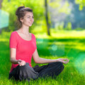 Young woman doing yoga exercises Stock Photography