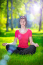 Young woman doing yoga exercises Royalty Free Stock Photography