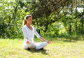 A young woman doing yoga in a green forest Royalty Free Stock Photo