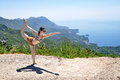 Young woman doing yoga pose at the sea Royalty Free Stock Images