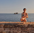 Young woman doing yoga pose at the sea Stock Image