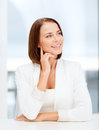 Young woman dreaming in office business concept Stock Photography
