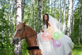 Young woman in the dress of fiancee on a horse Royalty Free Stock Photo