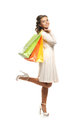 A young woman in a dress holding shopping bags Royalty Free Stock Images