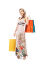 A young woman in a dress holding shopping bags beautiful and happy with isolated on white Royalty Free Stock Photos