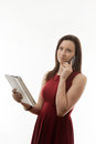Young woman in dress using a tablet and on her mobile phone at the same time Royalty Free Stock Photo