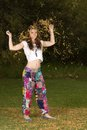 Young woman dressed in bohemian hippy style beautiful dancing the open bush Royalty Free Stock Photos