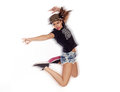 Young woman dressed in urban style clothes jumping dancing clubbing Royalty Free Stock Photo