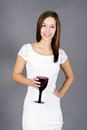 Young woman with drink beautiful natural in white lace dress smiling Stock Photo