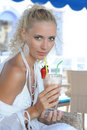 Young woman drinking cocktail Stock Photos