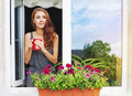 Young woman drinking coffee on a balcony pretty Royalty Free Stock Images