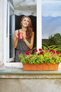 Young woman drinking coffee on a balcony pretty Royalty Free Stock Photo
