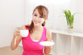 Young woman drinking coffee beautiful or tea at home in the morning healthy lifestyle concept asian beauty Stock Images
