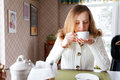 Young woman drinking coffee cup hot aromatic beverage coffee break Stock Photos