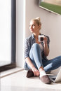 Young woman drinking coffee enjoying relaxing lifestyle Royalty Free Stock Photo