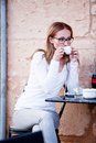 Young woman is drinking coffee outdoor in summer Royalty Free Stock Photo