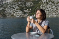 Young woman drinking coffee and using smarphone in the morning a