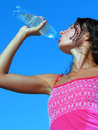 Young woman drinking cold water in hot day thirst vertical composition Royalty Free Stock Photos