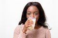 Young woman drinking a glass of fresh milk Royalty Free Stock Photo