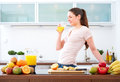 Young woman drinking a glass of orange Juice in the kitchen.III Royalty Free Stock Photo