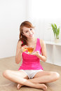 Young woman drinking hot tea beautiful at home with wood floor in the morning healthy lifestyle concept asian beauty Royalty Free Stock Image