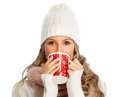 Young woman drinking hot tea. Royalty Free Stock Photo