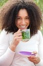 Young woman drinking mint tea close up portrait of a beautiful outdoors Royalty Free Stock Photo