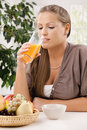 Young woman drinking orange juice Royalty Free Stock Photo