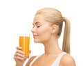 Young woman drinking orange juice picture of Royalty Free Stock Photos
