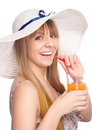 Young woman is drinking orange juice wearing summer hat and isolated over white Royalty Free Stock Photography
