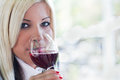 Young woman drinking red wine blonde Royalty Free Stock Photos