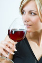 Young woman drinking red wine white background Royalty Free Stock Images