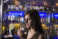 Young woman drinking tea at bar closeup of a thoughtful a recreational Stock Photography