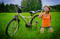 Young woman drinking water on grass Stock Images