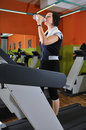 Young woman drinking water while working out Royalty Free Stock Photo