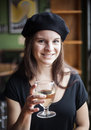 Young Woman Drinking White Wine Stock Image