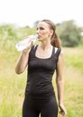 Young woman drinks water after making sport exercises Royalty Free Stock Photo