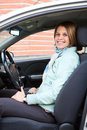 Young woman on driver seat Stock Photography