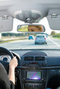 Young woman driving by car on motorway Royalty Free Stock Photos