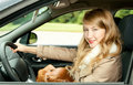 Young woman driving her new car Royalty Free Stock Photo