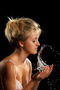 Young woman with drops of water around her face Royalty Free Stock Images