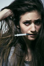 Young woman drug addict depressed close up Royalty Free Stock Photo