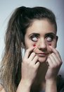 Young woman drug addict depressed close up Royalty Free Stock Image